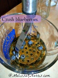 Crush blueberries for Blueberry Basil Thyme Vinegar
