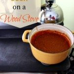 Image of a wood stove with a large stock pot of soup on top. Text overlay says,