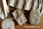 Image of bars of soap with decorative twine. Crochet and needle point projects are to the top and side.