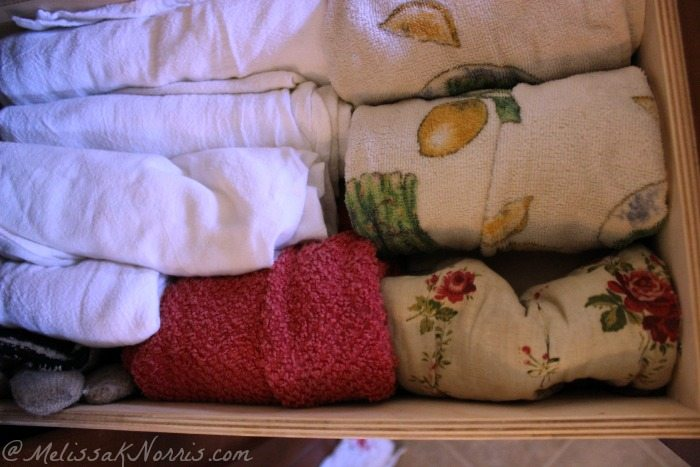 7 Steps to a Clutter Free Kitchen. Roll up towels and oven mitts for an quick glance and easy closing drawers.