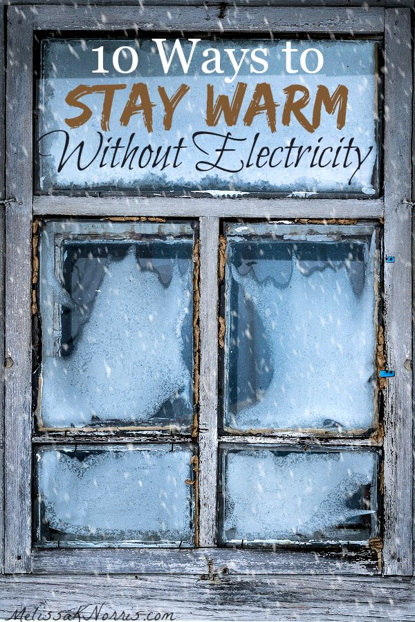 "Stormy window with text overlay ""10 Ways to Stay Warm Without Electricity"" Pinterest Pin."