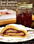 """Image of a slice of jam roly poly served on a decorative plate. A jar of raspberry jam is sitting in the background. Text overlay says, """"Great-Grandma's Jam Roly Poly - Vintage War Rations Recipe""""."""