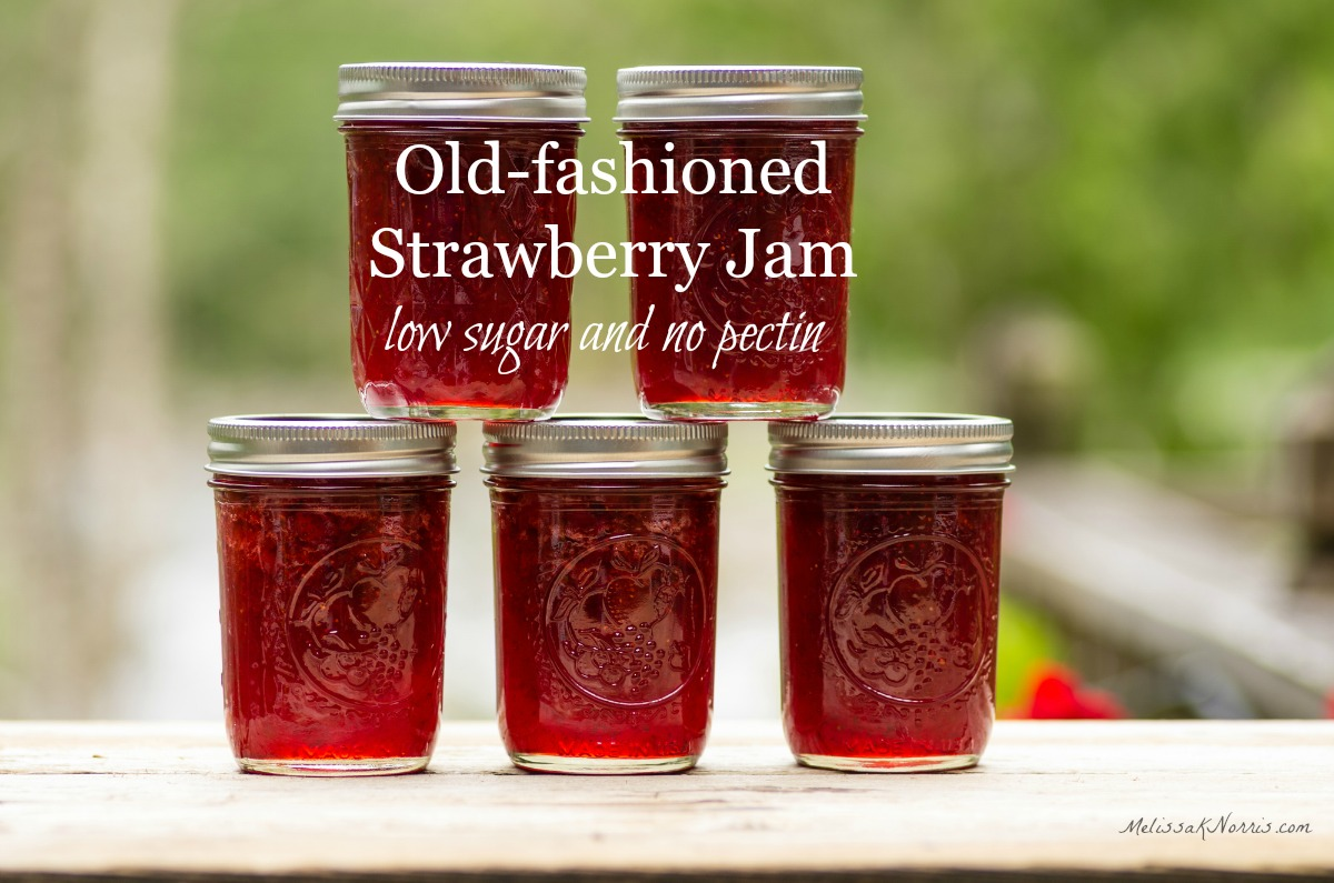 five jars of homemade jam without pectin stacked on a railing.