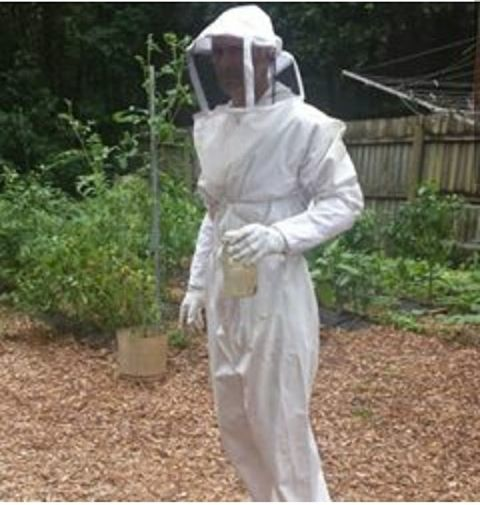beekeeper in full suit
