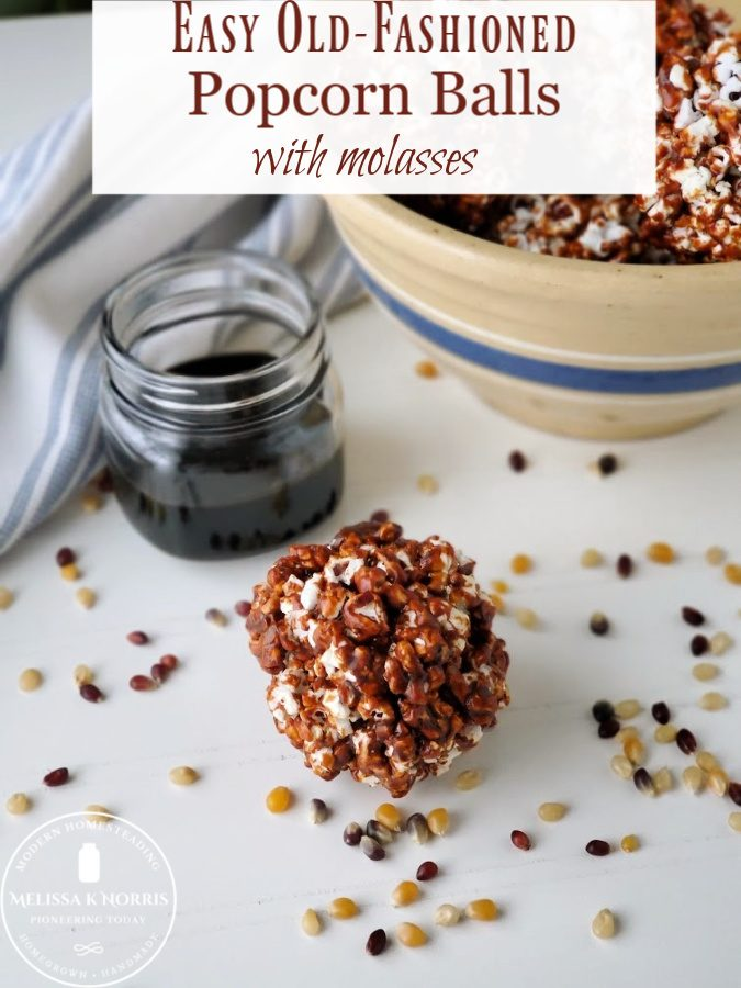 Old fashioned popcorn balls with molasses on wooden table