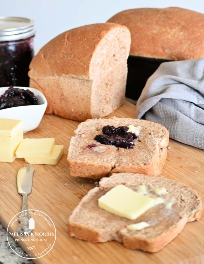 Honey whole wheat bread with butter and jam