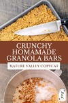 "Two images, one of a pan of granola bars, the other a bowl of ingredients. Text overlay says, ""Crunchy Homemade Granola Bars""."