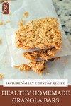 "Image of granola bars stacked on top of each other. Text overlay says, ""Healthy Homemade Granola Bars""."