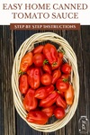 """Pinterest pin with a basket of fresh picked tomatoes. Text overlay says, """"Easy Home Canned Tomato Sauce Step By Step Instructions""""."""
