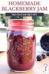 Jar of canned blackberry jam.
