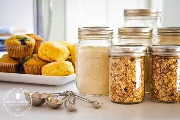 pouring flour into Mason jar for homemade pancake mix