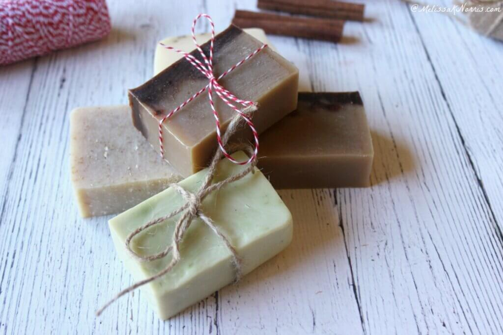 Homemade soap tied with twine as gifts sitting on a table.