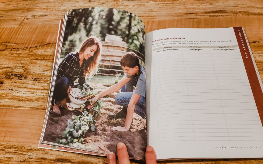 Family Garden Plan open to a picture of a mother and daughter gardening.