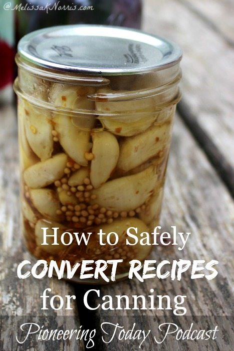 """Image of a mason jar filled with canned garlic cloves. Text overlay says, """"How to Safely Convert Recipes for Canning""""."""