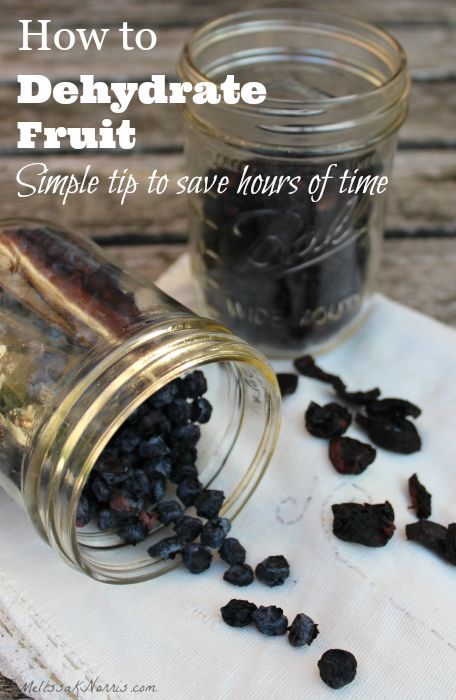"Two mason jars filled with dehydrated fruit. Text overlay says, ""How to Dehydrate Fruit""."