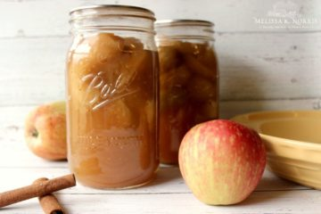 """Pinterest Pin containing several images of apples, a 4 oz. Mason jar filled with apple butter, quart sized Mason Jars filled with apple pie filling, and pint size Mason Jar filled with apple cider vinegar. Text overlay says, """"11 Easy Ways to Preserve Apples at Home""""."""