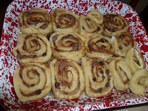 Cinnamon rolls placed into a baking dish.