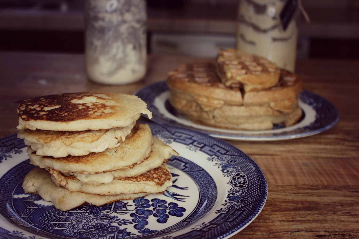 """Pinterest pin with two images. Top image is of three jars of bubbly sourdough starter. Bottom image is of bread and pancakes made with sourdough starter. Text overlay says, """"5 Tips on How to Get Started With Sourdough""""."""