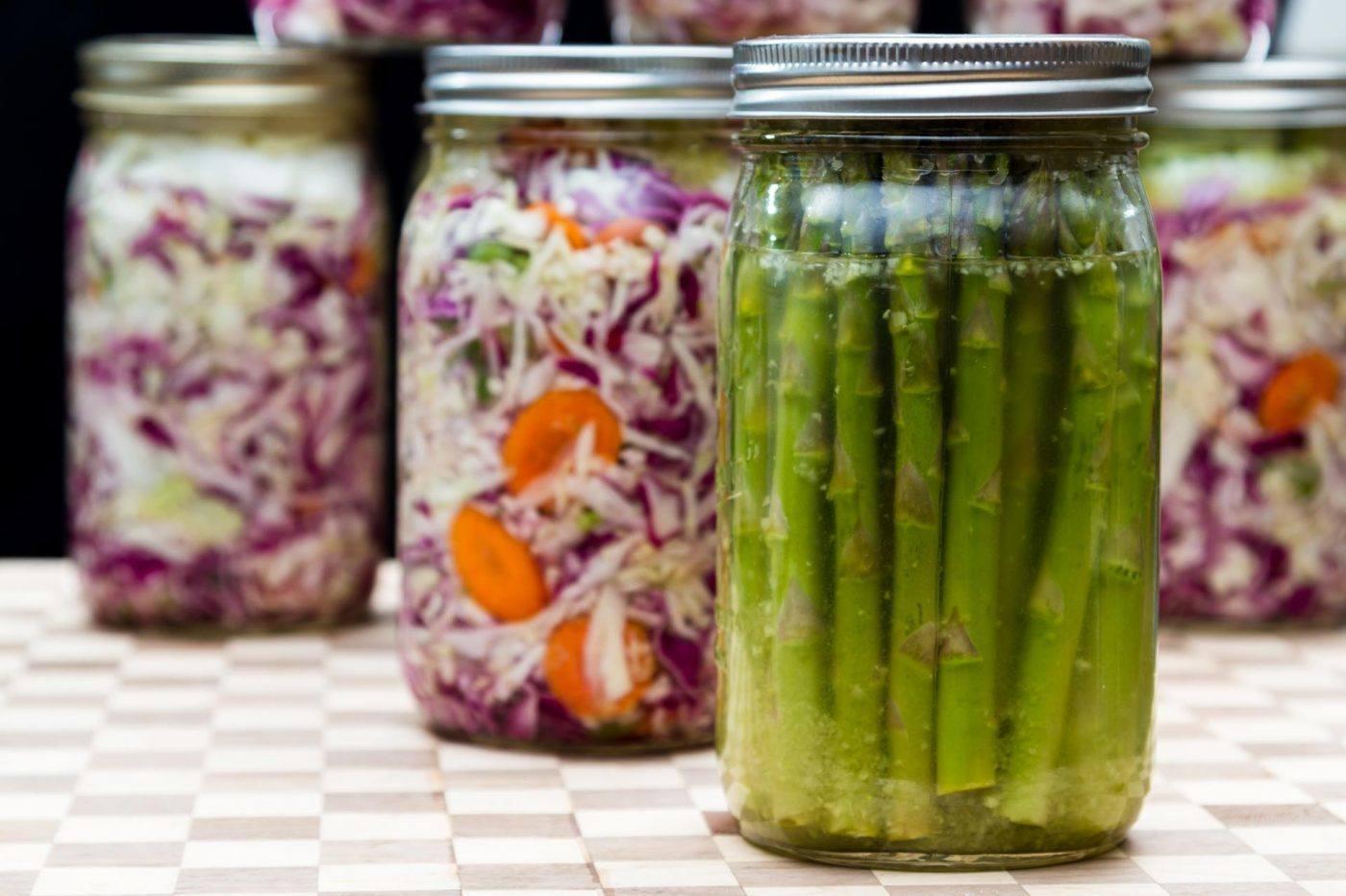 fermented asparagus and sauerkraut in mason jars