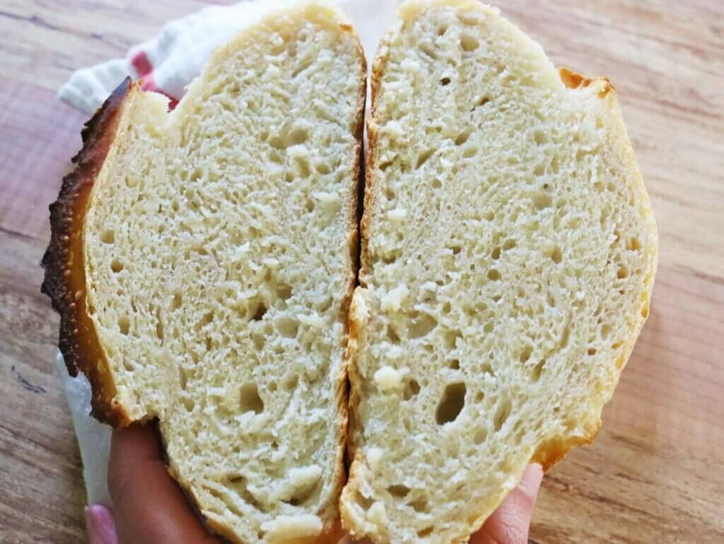 Artisan bread sliced open to reveal the crumb.