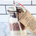 Pinterest pin for DIY Brownie Mix in a mason jar, with photos of brownie mix in a mason jar.