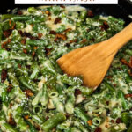 Pinterest pin with an image of green bean casserole and a wooden spoon.