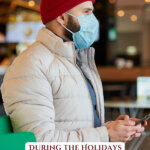 Picture of a man in a red beanie wearing a mask. Pinterest pin for Dealing with emotions surrounding COVID and the holidays.