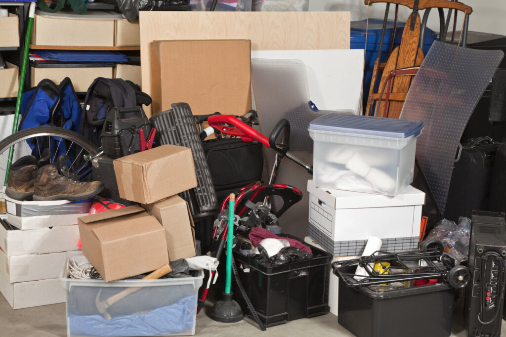 Photo of a very cluttered and messy garage.
