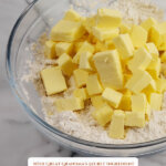 Pinterest pin for the best flaky pie crust recipe with an image of a bowl of flour and butter cubes on top.