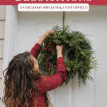 Pinterest pin of a woman hanging a homemade wreath on the front door.