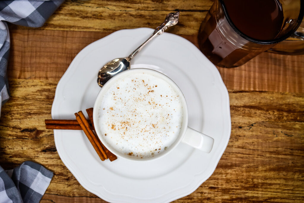 Image of a white cup with a frothy chai tea latte.