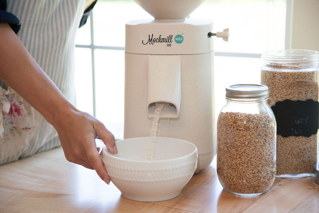 Mockmill grain mill grinding grain into a white bowl.
