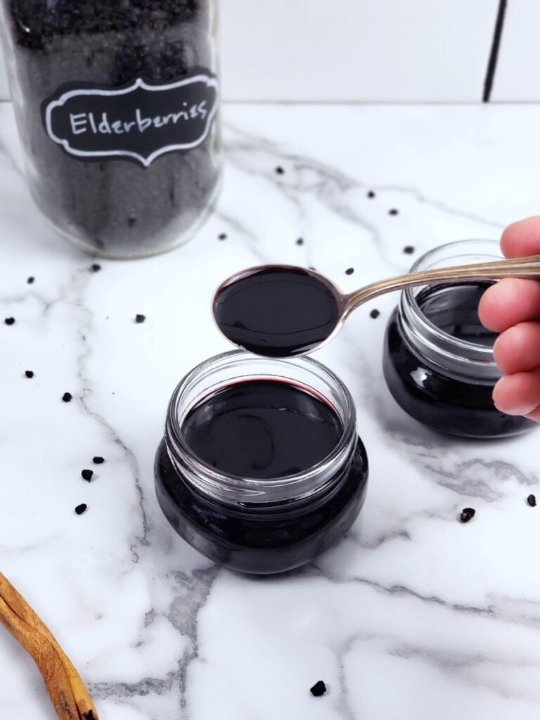 A spoonful of elderberry syrup.