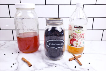 Ingredients for elderberry syrup: honey, dried elderberries and apple cider vinegar.