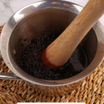 Pinterest pin for homemade elderberry syrup with images of elderberry syrup.