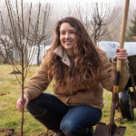 Pinterest pin for homesteading time management with an image of a woman planting a fruit tree.