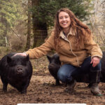 Pinterest pin for homesteading time management with an image of a woman next to a guinea hog.