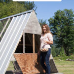 Pinterest pin for homesteading time management with an image of a woman standing on a chicken tractor.