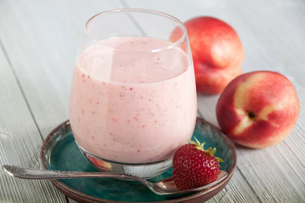Homemade strawberry peach milk kefir in a glass.