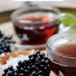 Pinterest pin for elderberry recipes with an image of elderberry tea.