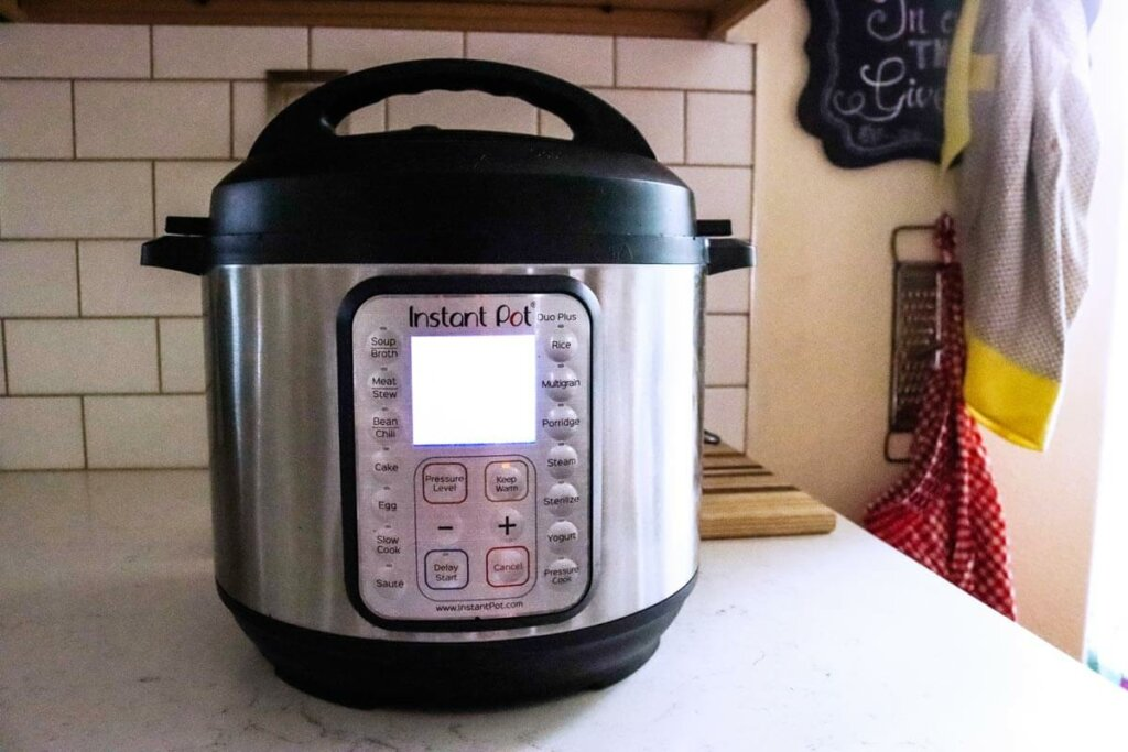An Instant Pot sitting on the kitchen counter.