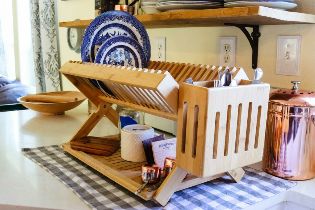 Wooden drying rack sitting on a kitchen counter.