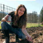 Pinterest pin for pest control in the garden from cabbage moths and slugs. Image of a woman kneeling in the garden holding a can of beer.