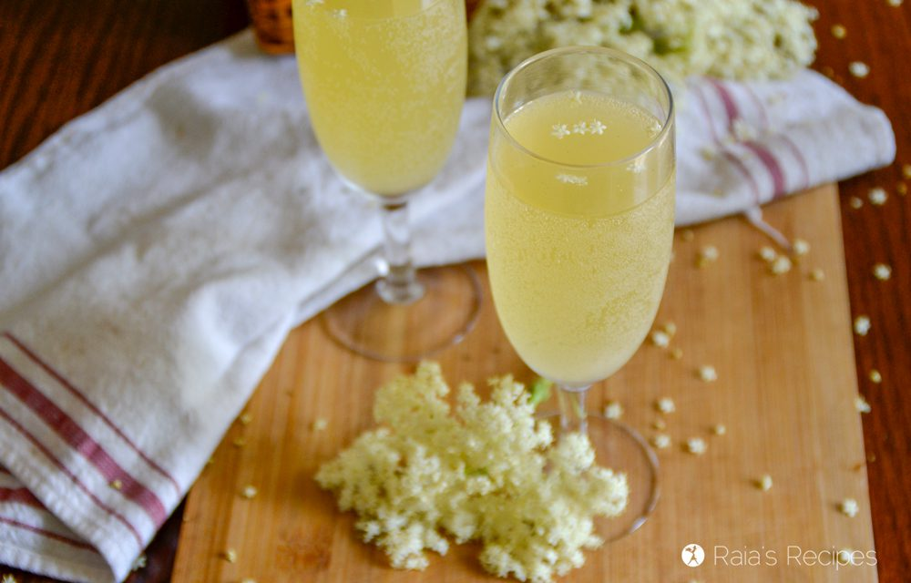 Two glasses of elderflower champagne.