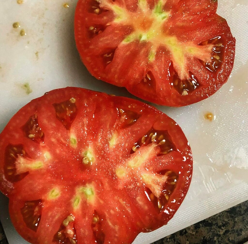 Image of a large tomato sliced in half.