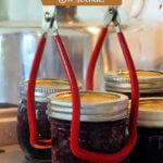 Pinterest pin for homemade cherry jam. Images of cherries and jars of jam.