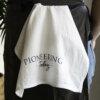 Pioneering Today Cotton Tea Towel tucked into apron around woman's waist