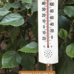 Pinterest pin for how to keep the house cool without electricity or ac. Image of an outdoor thermostat reading 110 degrees F.