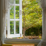 Pinterest pin for how to keep the house cool without electricity or ac. Image of an open window.