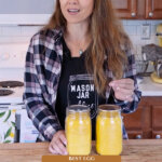 Pinterest pin for how to freeze dry eggs. Image of a woman holding a jar of freeze dried eggs.